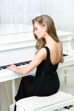 beautiful young women play piano